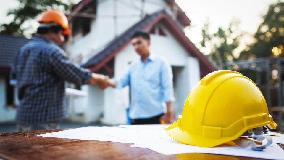 Shaking hands of partnership agreement between structural engineers and contractors to build houses.