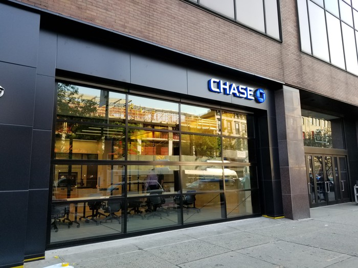 The exterior of a JPMorgan Chase branch on a city street.