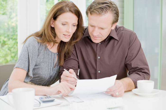 Couple reviews performance of their target-date funds in their 401(k).