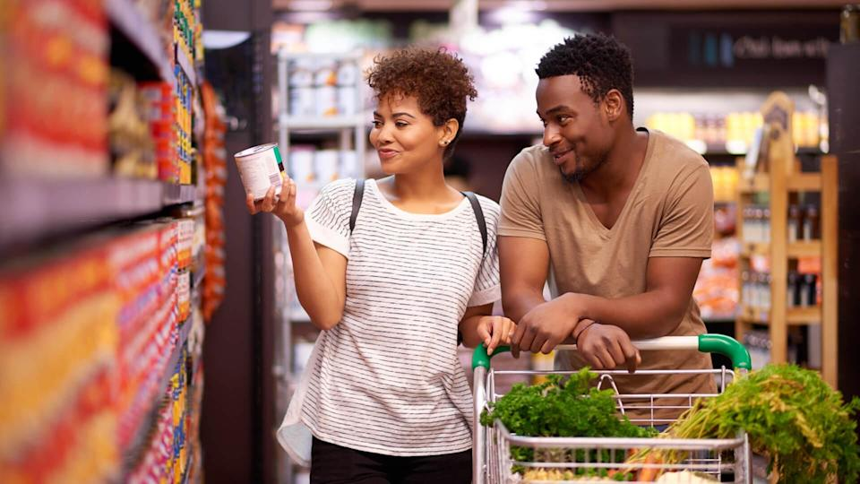 Shot of a young couple shopping in a grocery store.