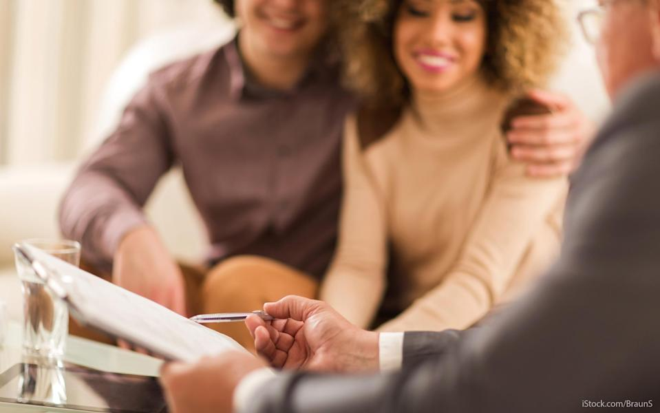 young couple consulting a financial professional