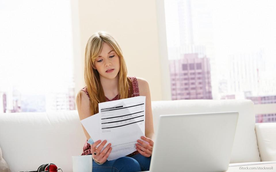 woman looking at her investment statements