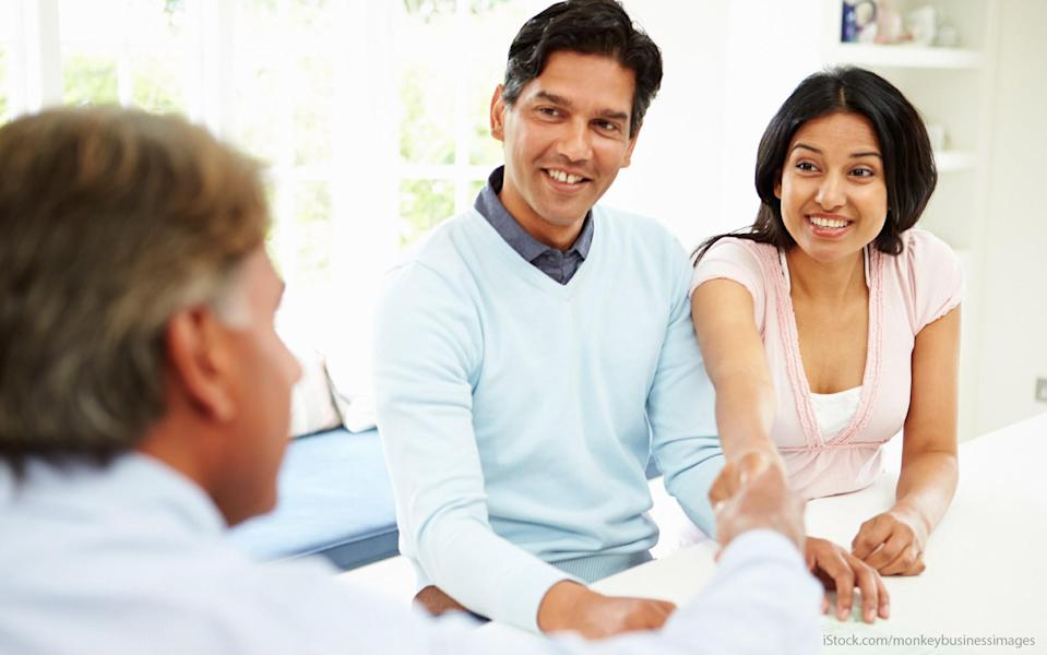 couple speaking with a financial professional