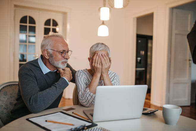 Older couple looking at computer.