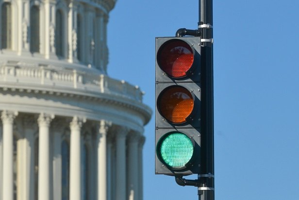 Nation's capitol building with green light in front of it