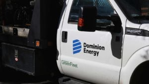 A side view of a Dominion Energy (D) pick-up truck.