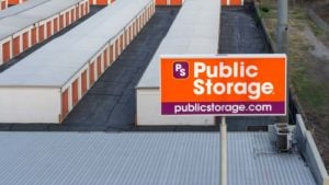 a Public Storage sign in front of a facility of storage buildings