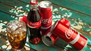coca-cola (KO) bottles and cans. coke is a blue-chip stocks