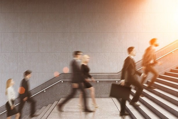 business professionals running up stairs